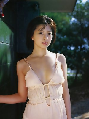 Exquisite asian chick displaying her delicious body in a bikini