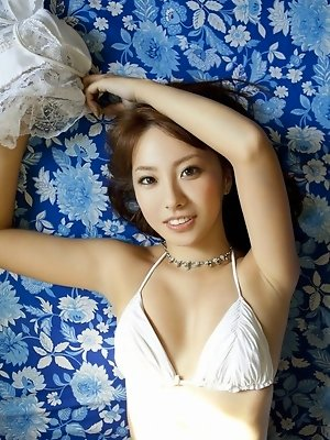 Gravure idol with a delicious body in red lingerie and stockings