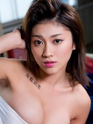 Big breasted gravure idol babe is to die for with her milky skin